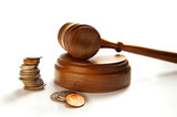 judges court gavel and assorted coins, on white