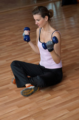 Woman Excercising with Blue Weights