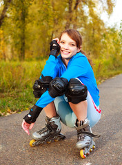 pretty happy girl with rollerskates