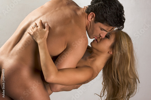 Naked mid aged interracial couple in love kissing