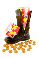 Boot with present and ginger nuts over white background
