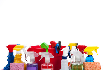 Various cleaning supplies on a white background