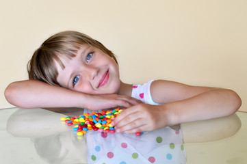 Littlel girl with colorful candies