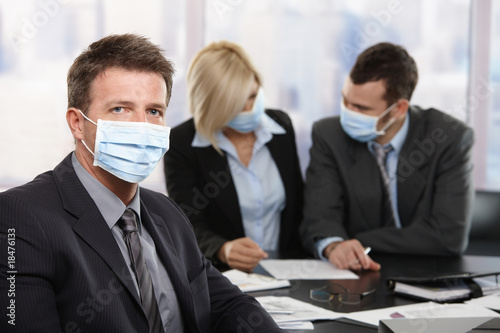 Business people fearing h1n1 virus