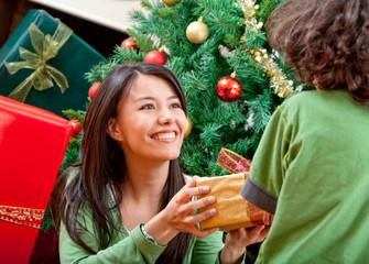 Christmas woman givin a present