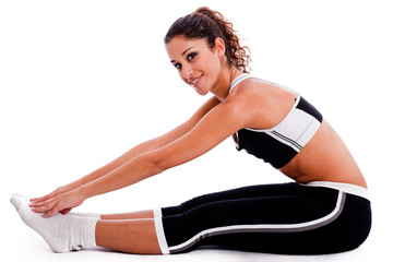 Young woman in fitness outfits stretching