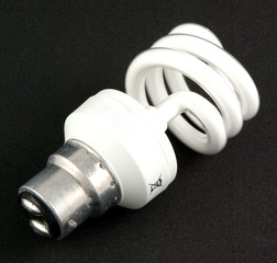 white energy saving bulb on black background