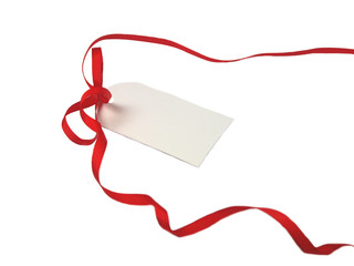 Empty gift tag with red ribbon on white background