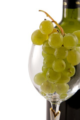 cluster of grapes in the wineglass