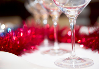 Wineglasses and red decorations in background