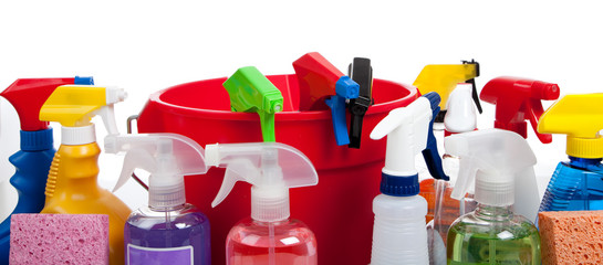 Cleaning supplies in a red bucket on white