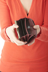 Young woman shows empty wallet