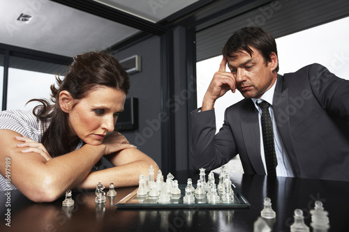 Businesspeople playing chess