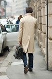 Business man with coat and case