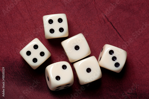 dice on red fabric