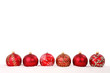 Red christmas baubles in line isolated