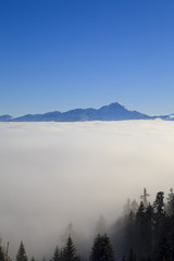 High in the mountains of the Alps in Austria above the clouds wi