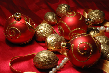 Red christmas balls and golden walnuts