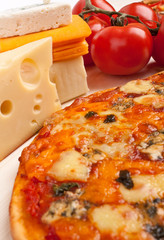 four cheese pizza with ingredients