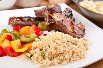 barbecue spare ribs with vegetables and couscous
