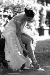 Bride adjusting stockings