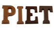 The word Piet in chocolate letter over white background