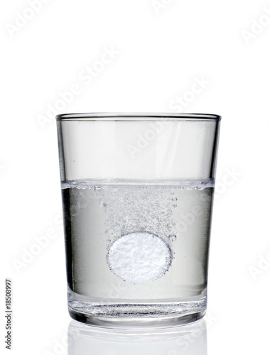 Aspirin tablet sparkling in a glass 01