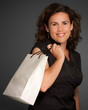 Smiling woman with shopping bag