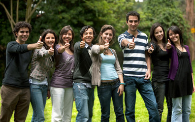 Large group of friends with thumbs up