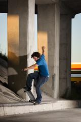 Skateboarder doing a grind on curb