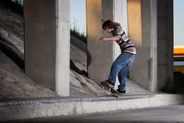 Skateboarder doing 5-0 grind on ledge