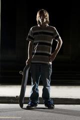 Backlit skateboarder portrait