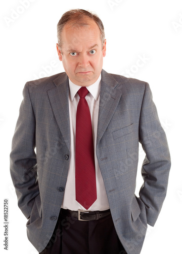 Serious Businessman with a Scowling Expression