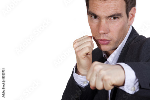 businessman throwing a punch
