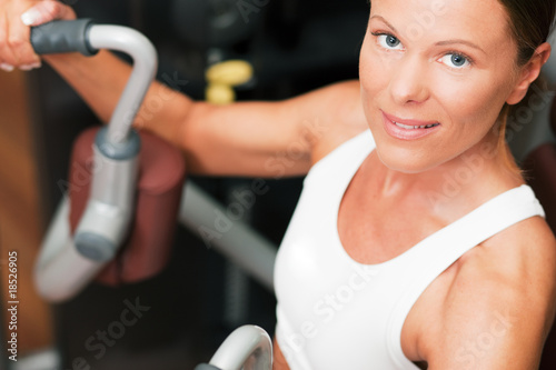 Woman in gym on machine