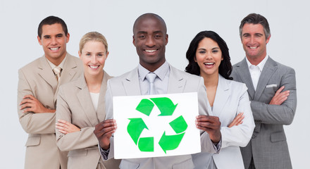 Business team holding a recycle symbol