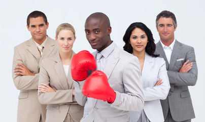 Afro-American businessman boxing and  leading his team