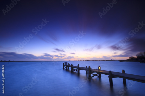 A tranquil sunset over a lake in the Netherlands