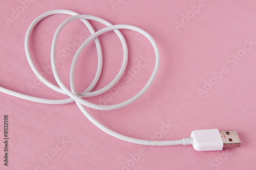 White USB Cable on Pink