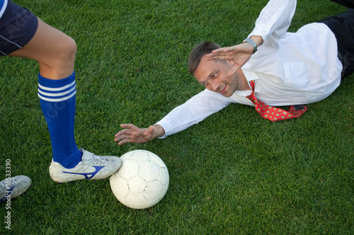 businessman catches the ball
