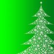 Leinwandbild Motiv Schneeflocken in Form eines Tannenbaums auf grünem Hintergrund