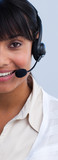 Close-up of an ethnic businesswoman with a headset on