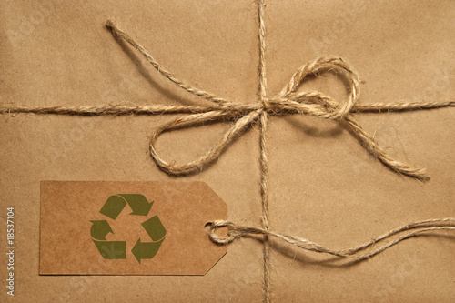 Brown shipping parcel tied with twine and tag for copy space - 18537104