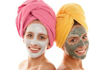 Teenage girls wearing facial masks