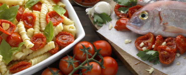 Pasta tomatoes and fish