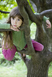 girl hang from a tree in the backyard poster