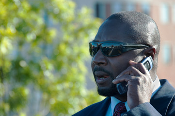 Businesman In Sunglasses Talking On Cellphone