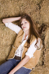 Woman relaxed on haystack