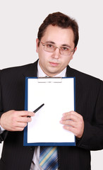 Young businessman with clipboard