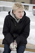 portrait of serious blond man in winter